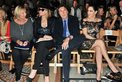 Actress Kim Cattrall, singer Bryan Ferry and model Kelly Brook have front row seats.