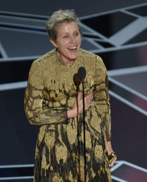 """Frances McDormand accepts the Oscar for Best Actress for her role in """"Three Billboards Outside Ebbing, Missouri"""". She urged the other female nominees in the audience to stand with her in a moment of solidarity (AAP)."""