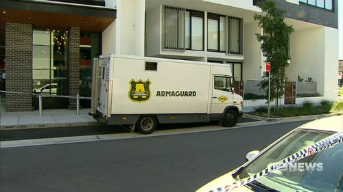 It began as a routine cash drop-off in the quiet heart of suburbia at 11am. (9NEWS)