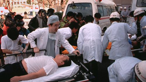 Members of the his Aum Shinrikyo cult punctured plastic bags to release sarin nerve gas inside train cars, killing 13 people and sickening more than 6,000.