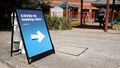 A sign guiding people is seen outside a NSW Health Pop-up COVID-19 clinic at Lakemba Uniting Church on October 15, 2020 in Sydney, Australia.