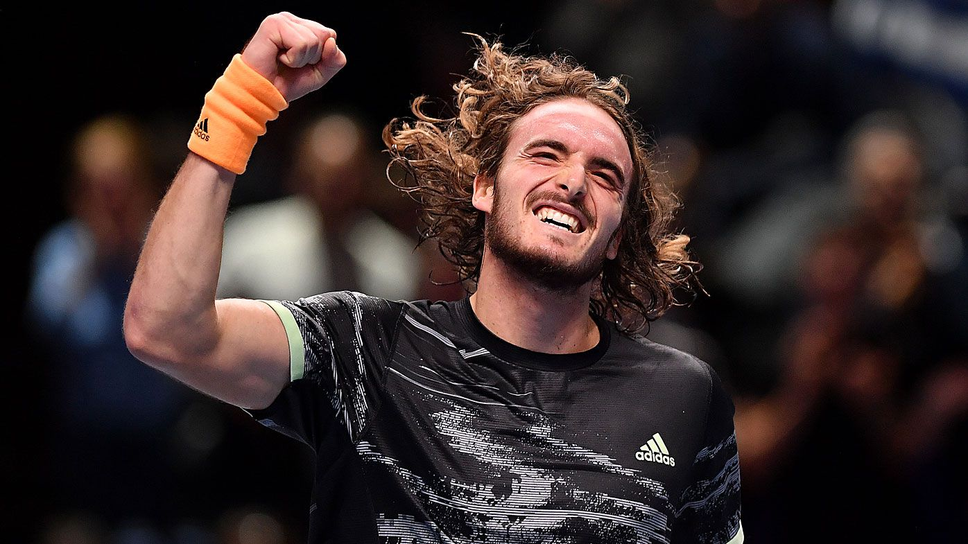 Stefanos Tsitsipas of Greece celebrates victory after his singles match against Daniil Medvedev