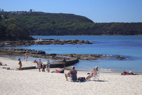 Sydneysiders enjoy the warm weather at Balmoral Beach at midday. (Picture: Cade Thompson)