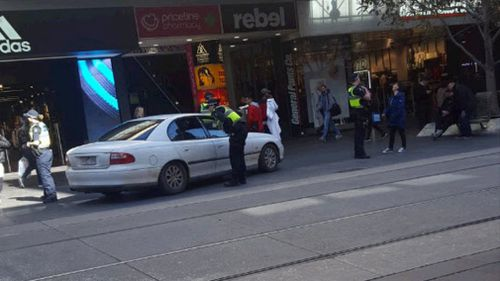 Police quickly swarmed the car after it allegedly 'took a wrong turn' down Bourke Street Mall.