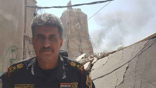 ISOF General Abdul Wahab al-Saadi outside the ruins of the leaning minaret of al-Nuri mosque. (Owen Holdaway)