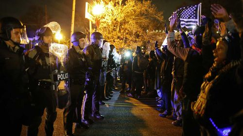 Police face off with protesters in Ferguson, Missouri, in 2014. (AAP)