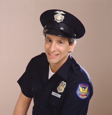 Charles Levin (as police officer Elliot Novak) in the TV show Alice