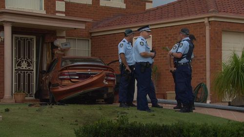 Man chases down driver who crashed into Sydney home after police pursuit