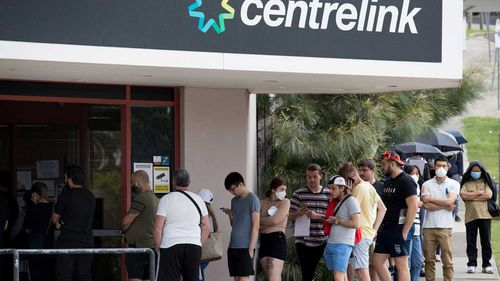 Newly unemployed Sydneysiders queue up outside a Centrelink in Rockdale.