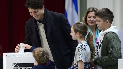 Justin Trudeau casts his ballot surrounded by family members this morning.