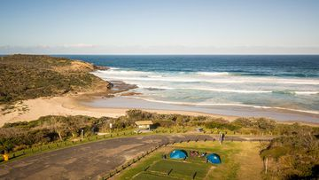 Despite the best efforts of surf lifesavers and other emergency service responders, a 55-year-old man died and his 20-year-old son is in hospital after getting into difficulty in a rip at Frazer Park Beach on the NSW Central Coast.
