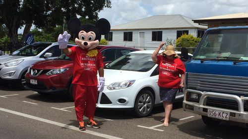 A Labor supporter wearing a Mickey Mouse costume attempted to ambush Senator Hanson during a meeting at a pub in Ayr (9News/Darren Curtis)