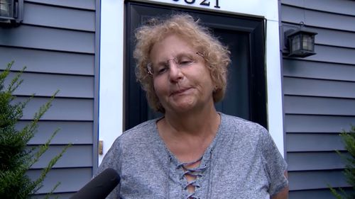 Robin Conway has been mauled to death in her yard by an adopted pit bull.