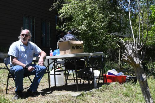 Mark Wearne, father of Belinda Peisley, sits at the scene waiting for news from the dig.