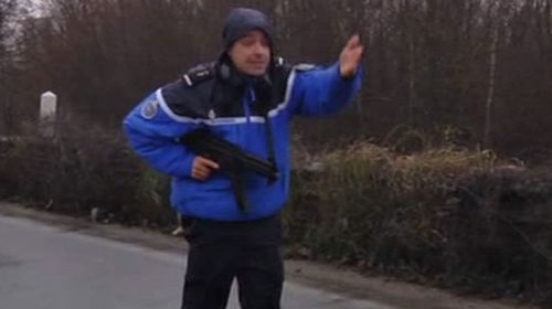 A police officer tells journalists to move away from the scene. (Sky News)