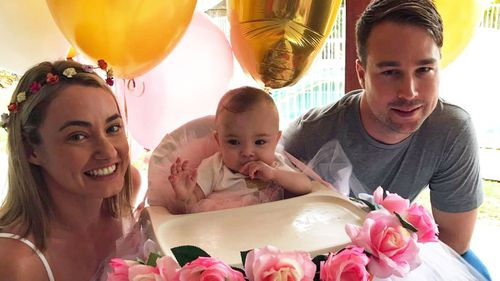 Billie Ava Stevens celebrating her first birthday with her parents. (Supplied)