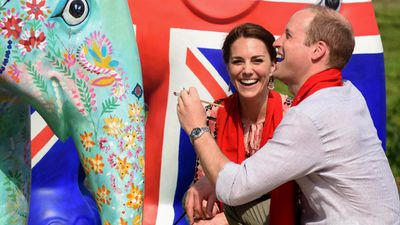 <p>The royals paint an elephant statue in the Kaziranga village of Panbari. </p><p>The statue is one of 200 that will be placed across India as part of a 'parade' for the Elephant Family charity.</p>