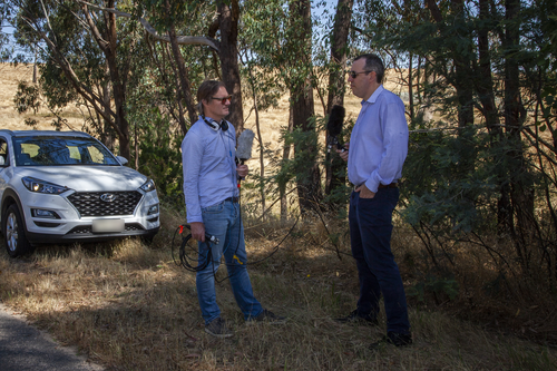 AFR journalist Angus Grigg interviews Professor Clinton Free, of the University of Sydney Business School, near the Beechworth Correctional Centre. Credit: Tim Mummery