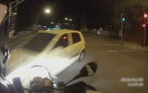 Dashcam shows motorcyclist hit by turning car on Brisbane road
