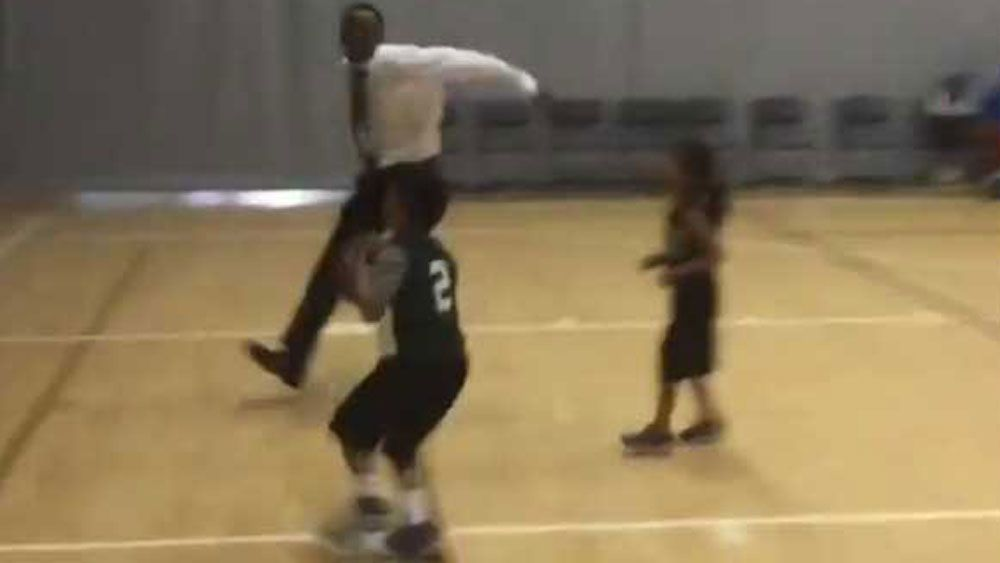 Junior basketball coach pulls out NBA-style block to stop wrong hoop shot