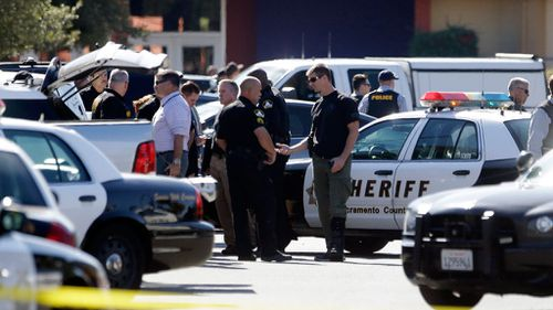 Police officers gather at the site where a Sacramento County Sheriff's deputy was shot. (AAP)