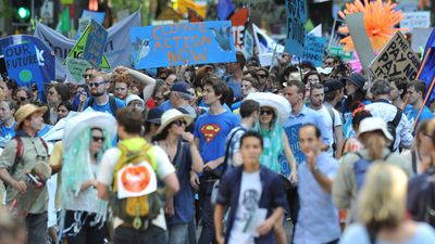 Marchers chanted the chorus of 'Hot, Hot, Hot' by Arrow as they marched down Macquarie St towards the Opera House in an ironic political statement on the state of the climate across the globe. (AAP)