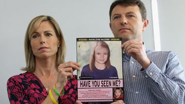 Kate and Gerry McCann hold an age-progressed police image of their daughter during a news conference to mark the 5th anniversary of the disappearance of Madeleine McCann (Getty)