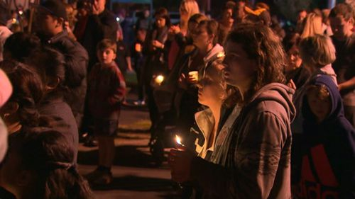 Thousands mourn the young mother's death.