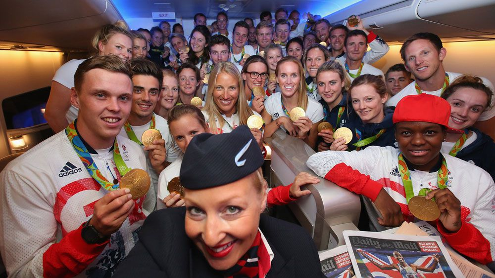 Team GB on board a British Airways flight home.