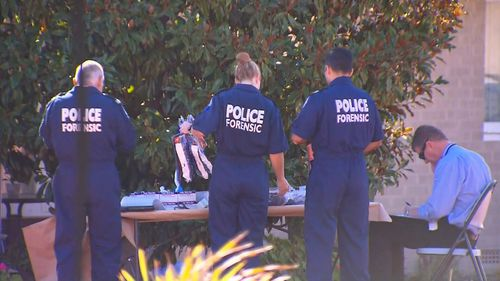 Forensic police at the Balga unit block today.