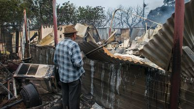 Property owner Jim returned to his destroyed home near Roseworthy to inspect the damage. (AAP)