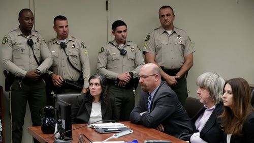 Defendants Louise Anna Turpin, left, with attorney Jeff Moore, and David Allen Turpin, right, with attorney Allison Lowe, appear in court for their arraignment in Riverside, California on January 18. (AAP)