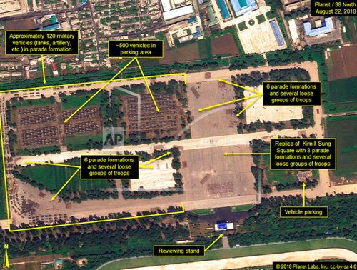 This August 22 satellite image provided by Planet/38 North shows the Mirim Parade Training Ground with approximately 120 military vehicles in parade formation and groups of troops practising on the roads and in a replica of Kim Il Sung Square.