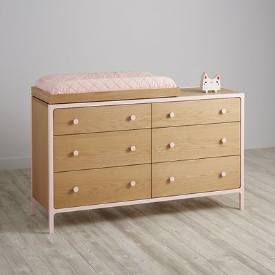 "<a href=""https://www.landofnod.com/larkin-6-drawer-changing-table-pink/f17056"" target=""_blank"">Larkin Change Table, $1060.</a>"