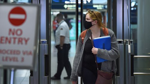 A passenger arrives at Sydney airport.