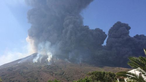A column of dense smoke rises from the crater of Stromboli volcano, where a powerful explosion occurred with sand, ash and other volcanic material falling on the surrounding area.
