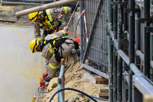 Fire-fighters conducted a high-angle rescue to free two of the trapped men.