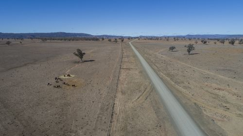 An aerial shot of Horton Rd, off Killarney Gap Road between Bingara and Narrabri, shows the extent of the drought.