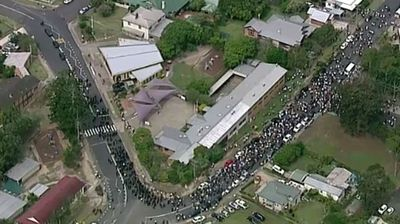 An aerial shot shows the sheer number of people who turned out to farewell the fallen cricketer. (9NEWS)