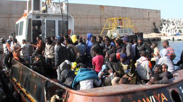 An oil tanker helped rescue about 135 people from boats off the Libyan coast. (AFP)