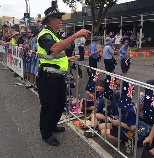 A South Australia policeman laughing at school kids trying to bribe him with a jam sandwich. (SA Police)