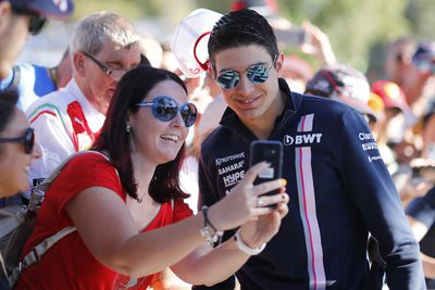 French  driver Esteban Ocon of Sahara Force India takes a photo with a fan. (AAP)