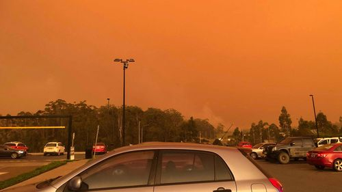 A photo red skies above the carpark at the Port Macquarie highway McDonalds when the bushfire threat emerged on November 8.