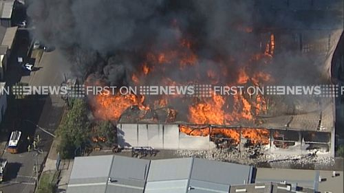 More than 300 people have been evacuated from the complex and surrounding businesses. (9NEWS)