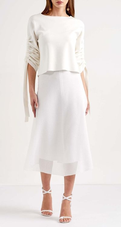 """<a href=""""https://www.scanlantheodore.com/collections/clothing//products/organza-skirt"""" target=""""_blank"""">Scanlan Theodore Organza Skirt in White, $300<br> </a>"""
