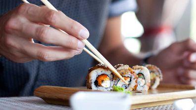 Man eats sushi
