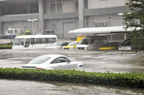 Water of high waves due to Tyhoon Jebi covers a parking area at Kansai International Airport in Osaka Prefecture