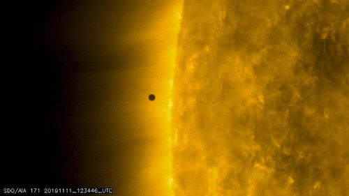 This still image from video issued by NASA's Solar Dynamics Observatory shows Mercury as it passes between Earth and the sun on Monday, November 11, 2019. The solar system's smallest, innermost planet resembles a tiny black dot during the transit.