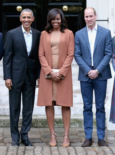Michelle Obama in a Narcisco Rodriguez coat at Kensington Palace with the Duke of Cambridge and Barack Obama