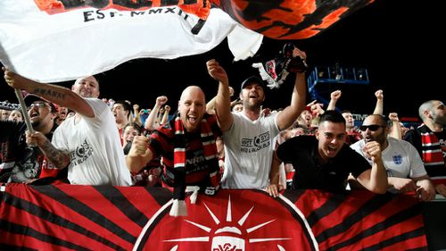 Wanderers fans celebrate the club's win. (AAP)
